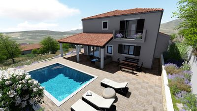 Photo for NEW! Villa Belina: 4 ensuite bedrooms, game room, heated pool, sauna & gym