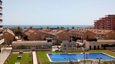 Photo for Panoramic sea views, terrace, garage, 24/7 security, beach in the city.