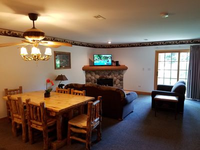 The family room is located right off the kitchen for a spacious event setting.