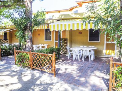 Photo for Bungalow with private veranda on a nice tourist village directly on the seafront
