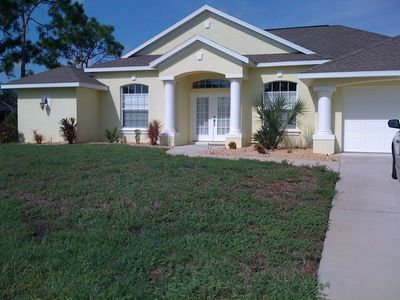Photo for Beautiful 4 BR/2 BA South-West Facing Home on a Freshwater Canal-Free HS Wi-Fi