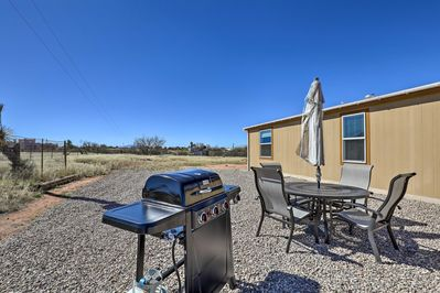 The vacation rental features 1.5 acres of enclosed land, perfect for horses.