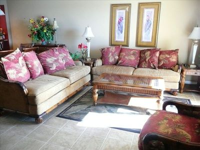 Living Room has 2 lg sofas, 2 chairs w/55' TV, VCR & DVD player n Armoire