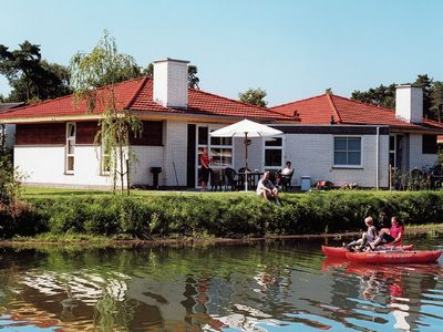 Photo for Attractive holiday home by the water in a park with beach and recreational lake