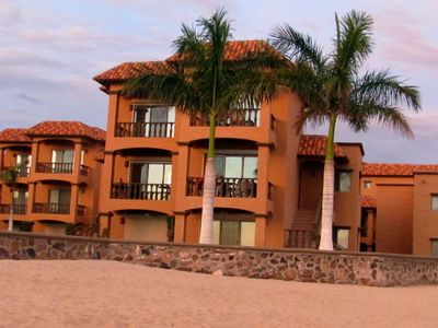 Exterior view from beach.  Our condo is on the left side on 2nd/3rd floor.