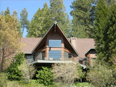 Front of mountain home that faces lake and golf course
