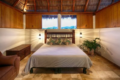 Master bedroom with 22 foot palapa roof, private sun patio & superb shower area