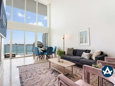 Photo for Sextant   2-Story Waterfront Condo #2   Heated Pool   10 mins to Miami Beach