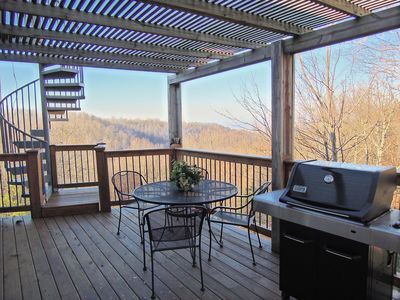 Rear Deck off of dining room and kitchen with gas grill.