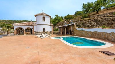 Photo for 4-bedroom holiday home with spacious terrace and panoramic views in Malaga province