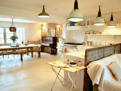 Vast kitchen, with 12 seater dining table , piano, bespoke antique pine kitchen