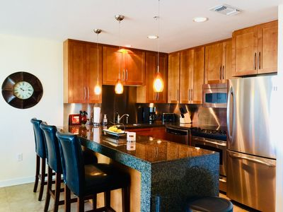Unit 808 Kitchen. Cherry Cabinets, Granite and Full Size Stainless Steel Appls