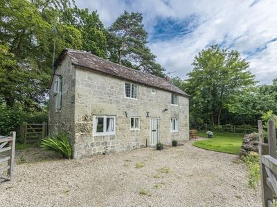 Photo for A cosy 18th Century cottage nestled in the village of Motcombe.