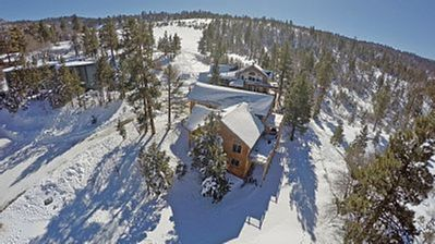 Aerial views of the property.  Perfect private hill to enjoy all winter sports