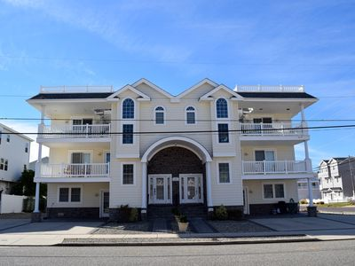 Photo for Beautiful 5 Bedroom 4.5 bath beach block townhome with a bonus room.