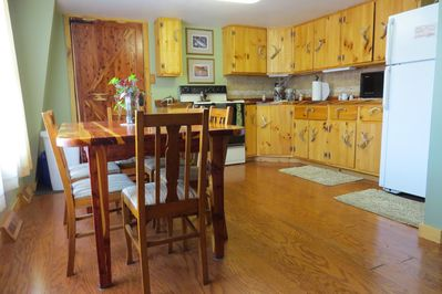 Full kitchen/dining area with Amish built cabinets in the Pine Unit.