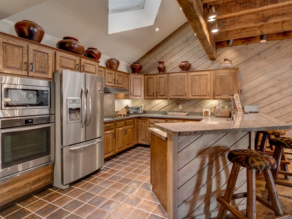 steamboat springs apartment rental large kitchen and bar with skylight stone slab counters