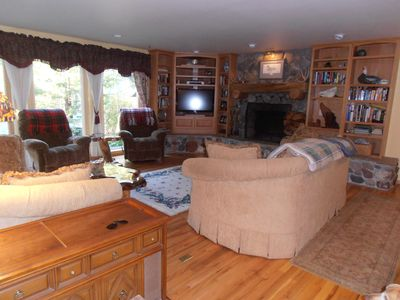 Our Cabin Themed Living Room with beautiful rock fireplace!