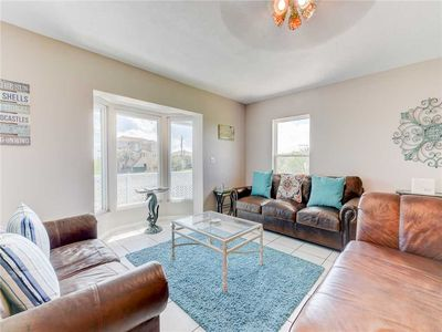 Room to Spread Out - There's plenty of space for everyone to relax in the living room on three inviting leather sofas.