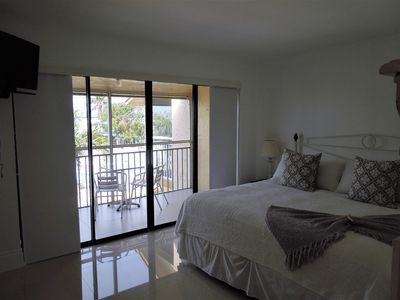 Photo for Refined. Safe. Clean.  Waterfront Kawama Yacht Club Townhouse.