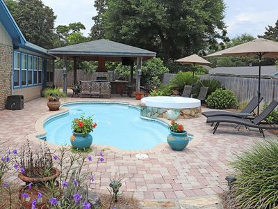 Photo for Beautiful 3000 sq ft of paradise with pool / hot tub and covered lanai.