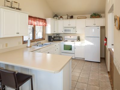 Bright and airy fully equipped kitchen has microwave, dishwasher & coffee maker