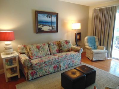 Photo for L3  Ocean Walk Resort is a downstairs two bedroom two bath condominium overlooking a nice park area.  This unit has a king and queen bedding, open and upgraded kithen area, hardwood floors in main living area, carpeted bedrooms.