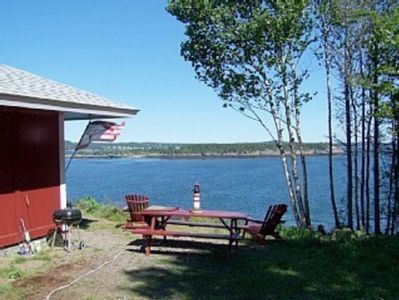 YOU CAN PARK RIGHT NEXT TO THE COTTAGE AND PICNIC TABLE OVERLOOKING THE OCEAN