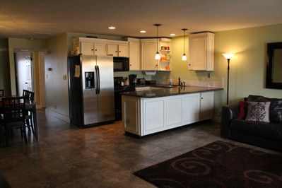 Open kitchen plan with island. fully equipped for all your needs