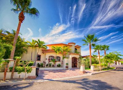 Front of Hacienda on quiet street in gated community with private parking
