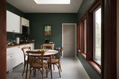 Sunny full kitchen with dining table