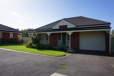 Self contained with large sunny enclosed yard with grassed and paved areas.