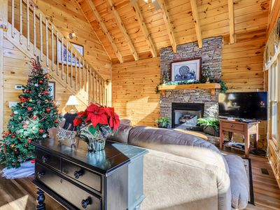 Photo for Lovely cabin w/ a private hot tub, beautiful mountain views, & shared pool!
