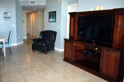 """Large Entertainment center 55"""" TV,DVD player & DVD collection, Leather recliner"""