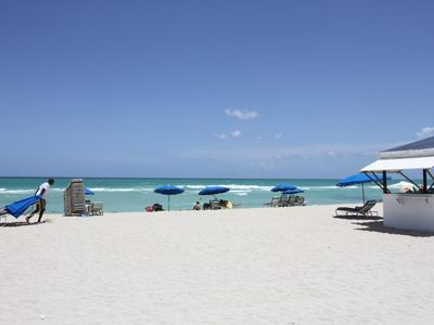 Photo for RIGHT ON THE BEACH! 1BR SUITE FOR 4, POOL!