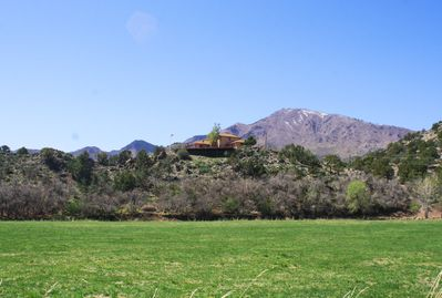 The house on the hill with the Pine Valley Mountains in the background.