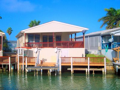 Photo for Dog-friendly, waterfront home w/ boat lift, access to shared pool, & hot tub