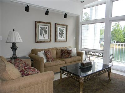 Enjoy lake views from your living room. Sofa & love seat convert to extra beds.