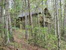 THIS CABIN IS TUCKED AWAY IN THE WOODS FOR YOUR ROMANTIC GETAWAY OF PRIVACY.