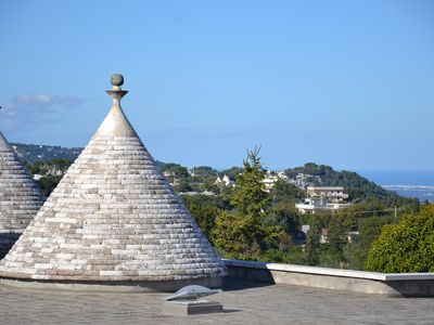 Photo for Pretty Apulian trullo nestled in the heart of the hills