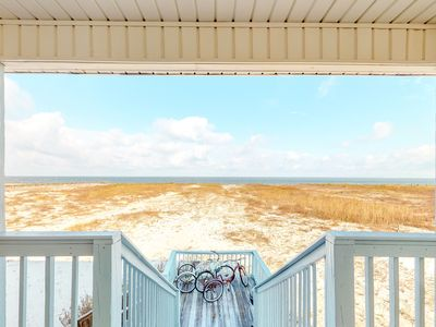 Photo for Waterfront beach house on the sound with breathtaking sunset views, gulf access