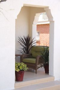 Read a book on the front patio while staying at Villa Blanca