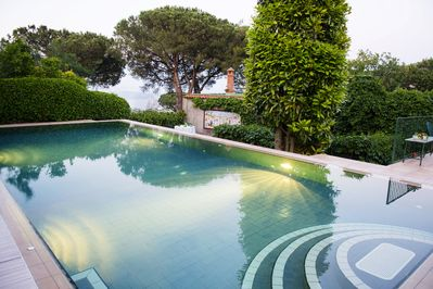 The infinity pool at Villa Beatrice looks out over the medieval Aragonese Castle