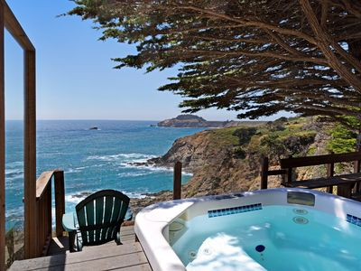 Photo for Elegantly updated home w/deck, fire pit, & private hot tub overlooking the ocean