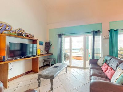 Photo for Lakefront villa w/ shared pool, balcony, free WiFi, & views - just 2km to town!
