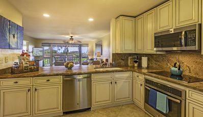kitchen with granite counter tops, new stainless steel appliances!