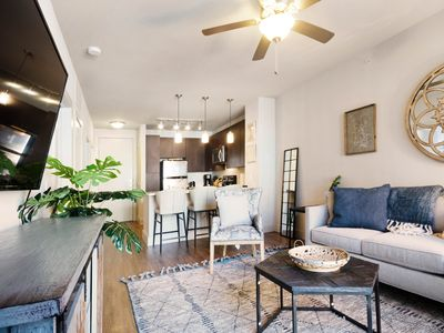 Photo for Modern condo w/ shared pool and hot tub - right downtown!
