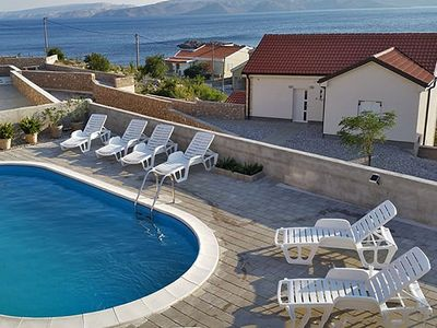 Photo for Apartment with pool overlooking the sea and the island of Pag