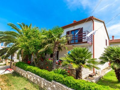 Photo for Attractive apartment with 2 bedrooms, 2 bathrooms, air conditioning, large garden with barbecue and only 800 meters to the sandy beach