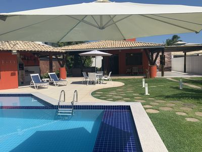 Photo for House with pool, barbecue, 250 meters from the best beach in Guarajuba.